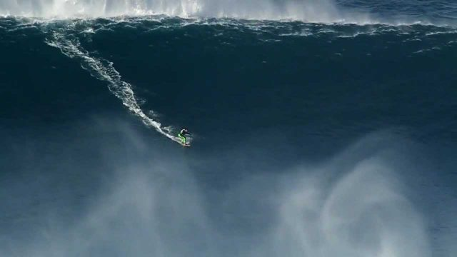 Kelly Slater and Joel Parkinson surfing big waves in Praia do Norte Nazare